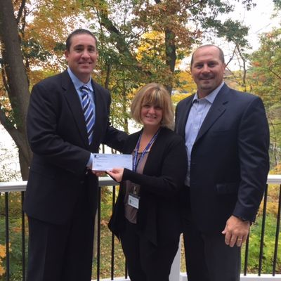 Sullivan Group presents check to The Rose Monahan Hospice Home